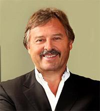 Alex Brisbourne, IMC chairman and CEO of KORE