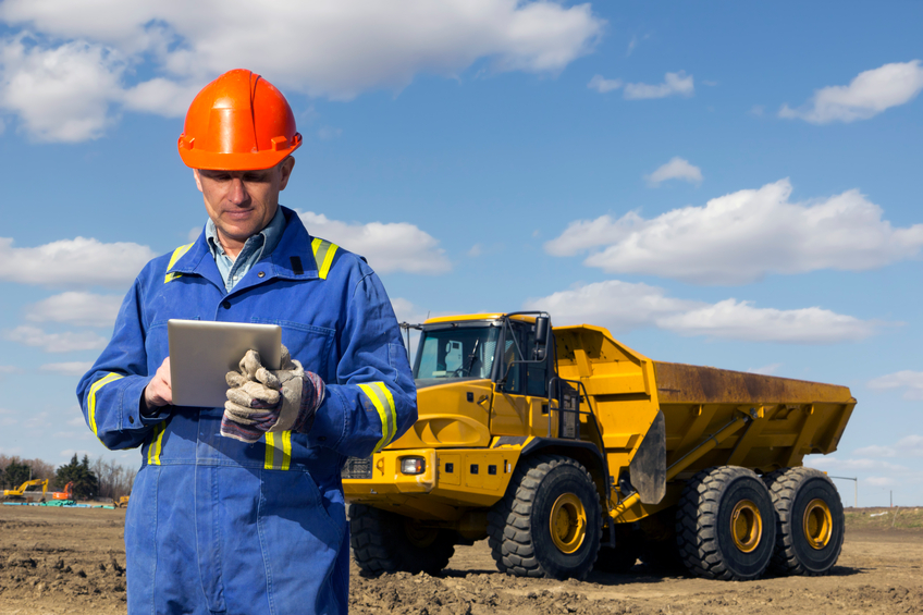 An image from the construction industry of a construction worker using a tablet.