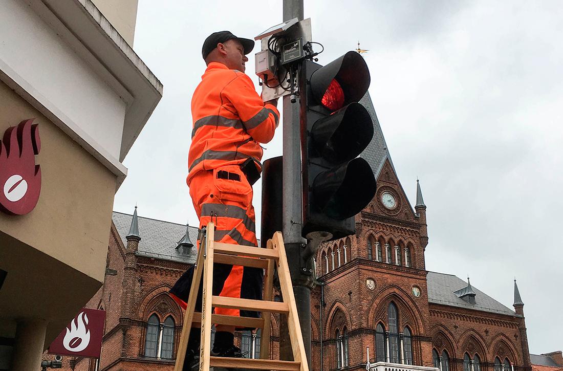 Technician installing sensor nodes in Vejle