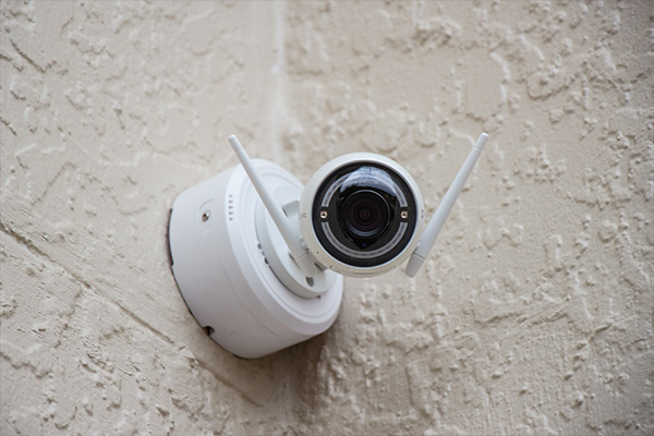 Security iot camera mounted to the wall